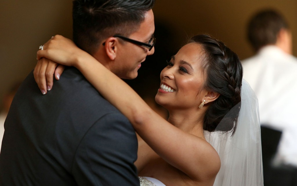 Hispanic bride and grooms first dance